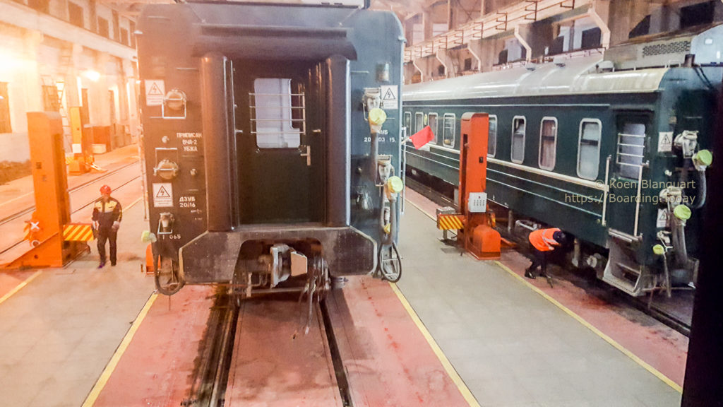 The train is being lifted to switch wheels to the right width for the Chinese system.
