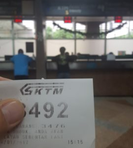 Waiting for my turn to buy the train ticket between Kuala Lumpur and Singapore KTM - Kuala Lumpur Sentral) - picture by Koen Blanquart