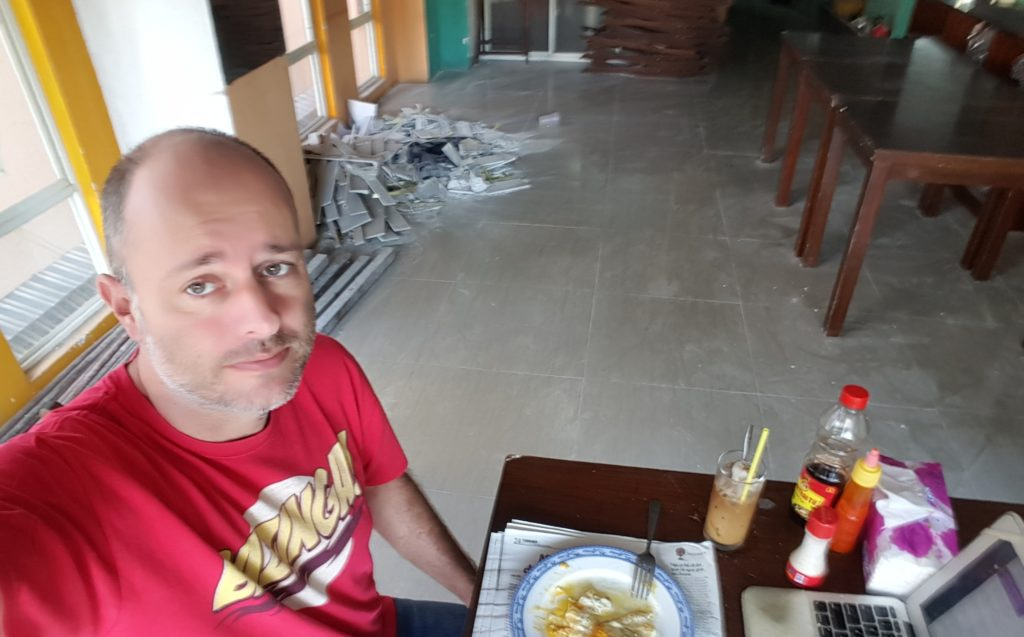 Koen Blanquart having breakfast in a construction site in Ho Chi Minh City, Saigon, Vietnam