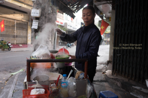 A woman serving Pho in Hanoi