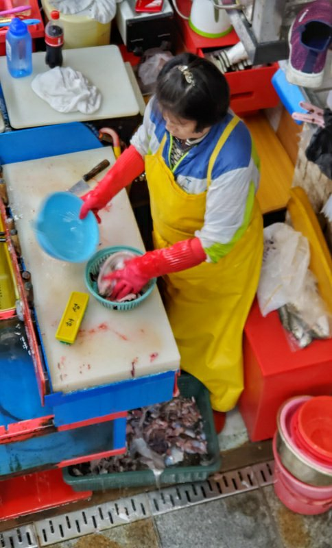 A woman cleaning fish in the Busan Fish Market